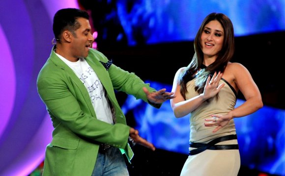 Khan performs a song with